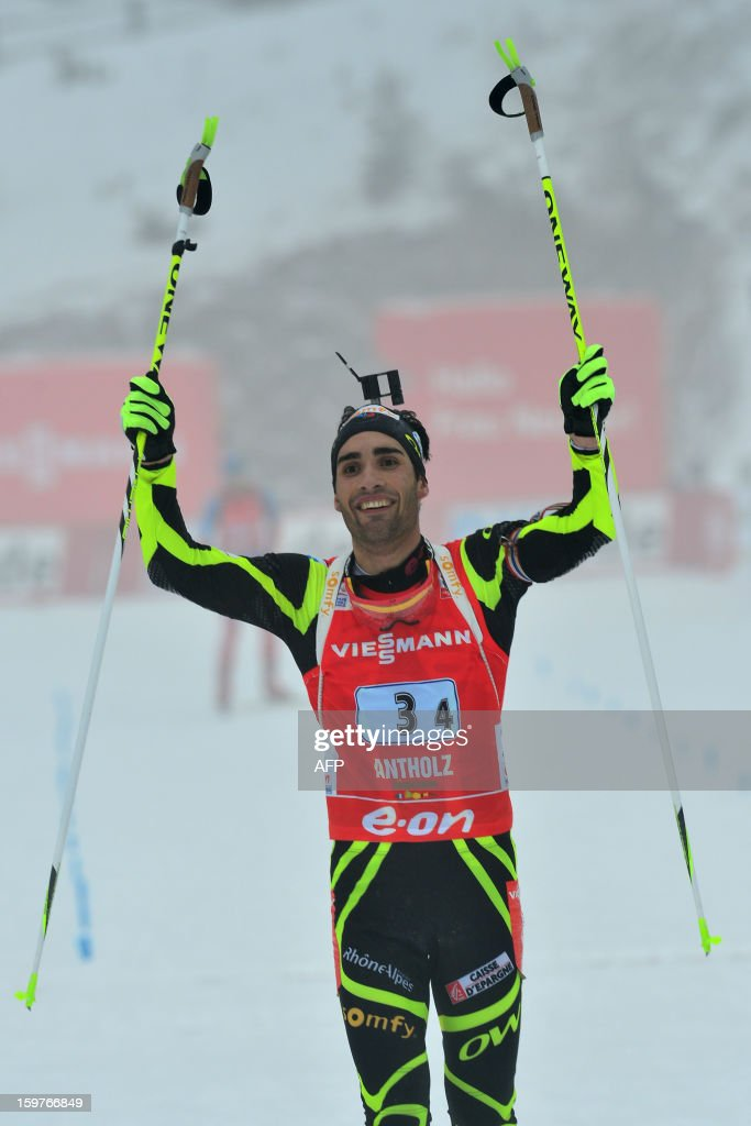 Winners France Martin Fourcade celebrates as he crosses in victory the finish line of the 4x7,5 kilometers' relay race of the men's biathlon World Cup race on January 20, 2013 in Antholz-Anterselva. France team won ahead of Russia and Austria.