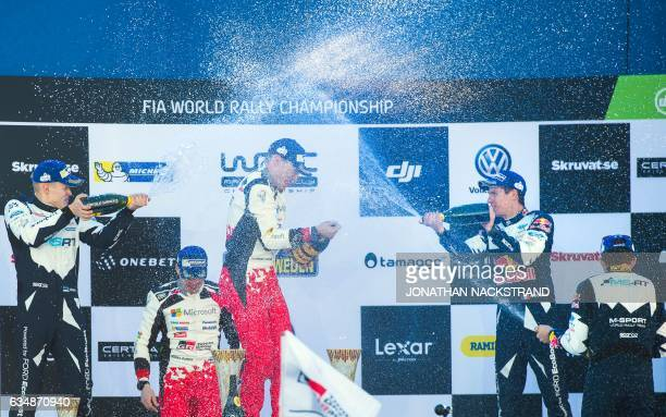 Winners Jari Matti Latvala of Finland and his codriver Miikka Anttila of team Toyota are being sprayed with champagne by third placed Sebastian Ogier...