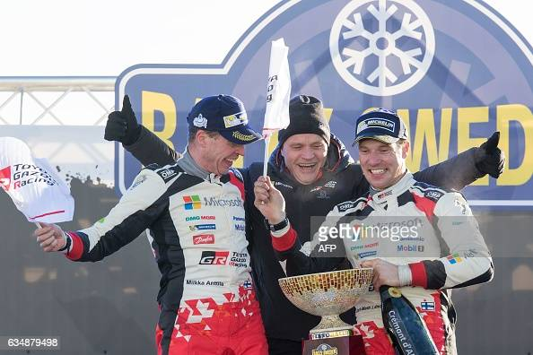 Winners Jari Matti Latvala of Finland and his codriver Miikka Anttila of team Toyota and their teamm manager Tommi Makinen celebrate during a winners...