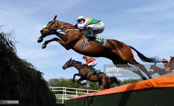 Winners Jason Maguire and Ballabriggs soar over the 4th last the open ditch during the John Smith's Grand National Steeple Chase at Aintree...