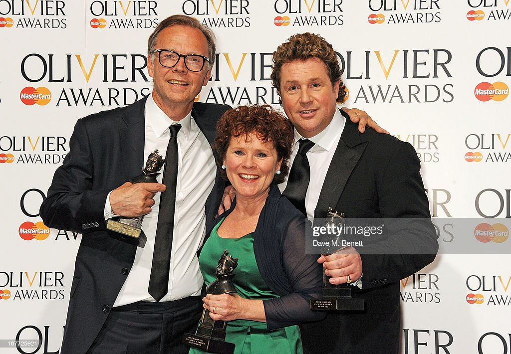 Winners Jonathan Kent, Imelda Staunton and Michael Ball pose in the press room at The Laurence Olivier Awards 2013 at The Royal Opera House on April 28, 2013 in London, England.