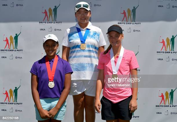 Winners Justine Pennycooke Cindy Song and Brooke Oberparleiter of the Girls 1213 Division during The Drive Chip and Putt Championship at Pinehurst...