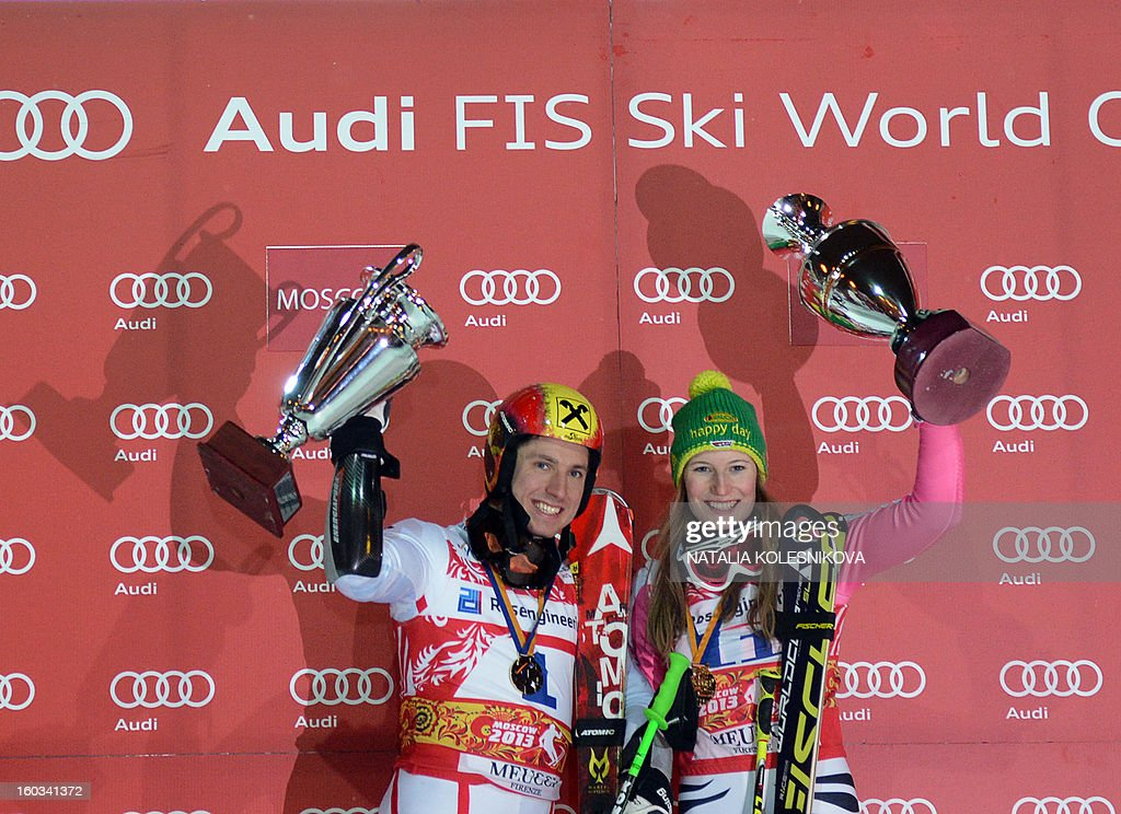 Winners Marcel Hirscher of Austria (L) and Germany's Lena Duerr (R) celebrate on the podium after the FIS Ski World Cup Parallel Slalom city event in Moscow on January 29, 2013.