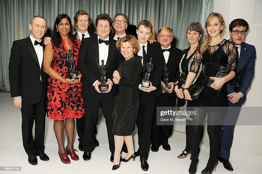 Winners Nicholas Hytner, Lolita Chakrabarti, Sir David Hare, Michael Ball, Jonathan Kent, Imelda Staunton, Matthew Tennyson, Simon Russell Beale, Soutra Gilmour, Hattie Morahan and Nick Payne attend an after party following the 58th London Evening Standard Theatre Awards in association with Burberry at The Savoy Hotel on November 25, 2012 in London, England.