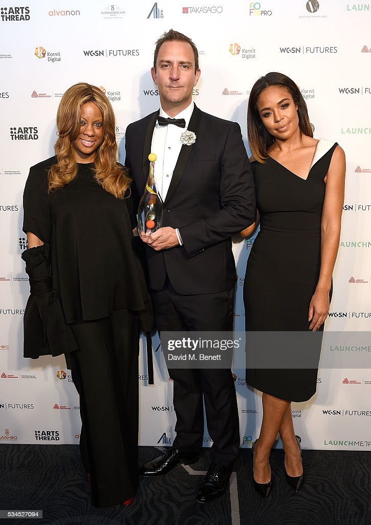 Winners of best Best E-store Award Stephanie Horton (L) and Elliot Jordan for Farfetch with presenter Sarah Jane Crawford at the WGSN Futures Awards 2016 on May 26, 2016 in London, England.