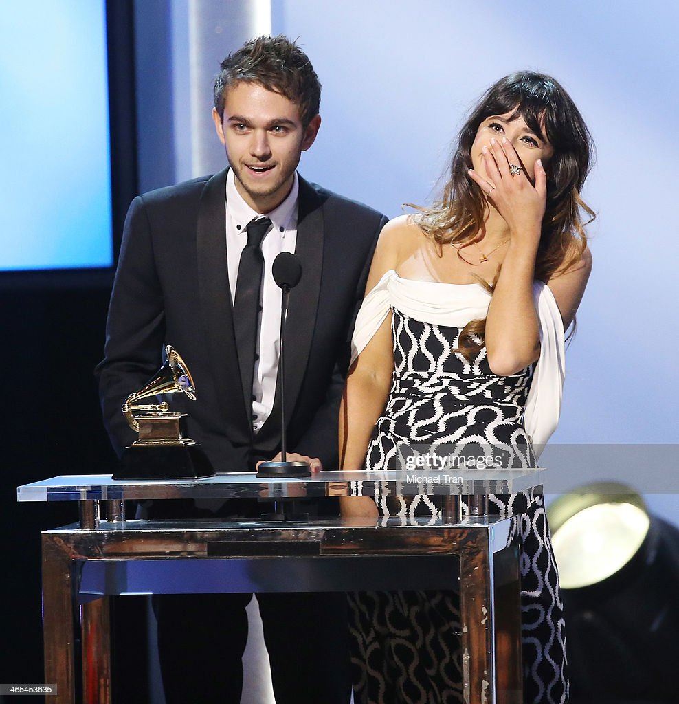 Winners of Best Dance Recording, <a gi-track='captionPersonalityLinkClicked' href=/galleries/search?phrase=Zedd+-+Musician&family=editorial&specificpeople=5830568 ng-click='$event.stopPropagation()'>Zedd</a> (L) and Foxes accept their award onstage during the 56th GRAMMY Awards held at Staples Center on January 26, 2014 in Los Angeles, California.