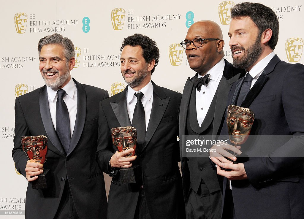 Winners of Best Film George Clooney Grant Heslov presenter Samuel L Jackson and Best Director winner Ben Affleck pose in the Press Room at the EE...