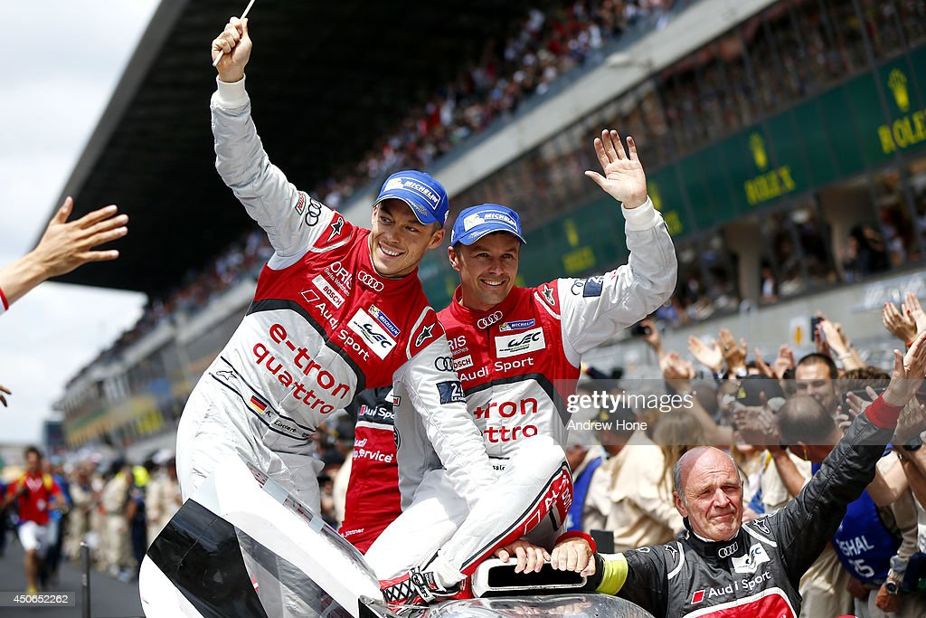 Winners of the 2014 Le Mans 24 Hour, Audi Sport Team Joest, Audi R18 E-Tron Quattro of Marcel Fassler, André Lotterer and Benoit Treluyer celebrate on the car with Wolfgang Ullrich of Austria, Head of Audi Motorsport on June 15, 2014 in Le Mans, France.