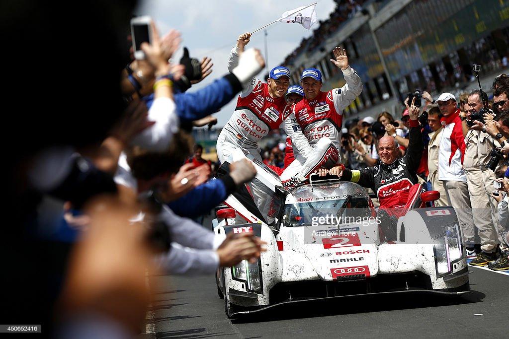Winners of the 2014 Le Mans 24 Hour Audi Sport Team Joest Audi R18 ETron Quattro of Marcel Fassler André Lotterer and Benoit Treluyer celebrate on...