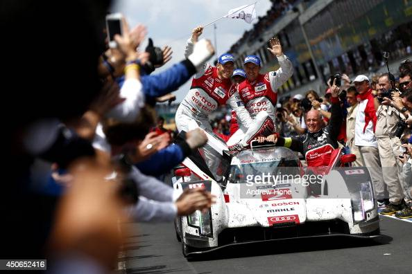 Winners of the 2014 Le Mans 24 Hour Audi Sport Team Joest Audi R18 ETron Quattro of Marcel Fassler André Lotterer and Benoit Treluyer celebrate on...