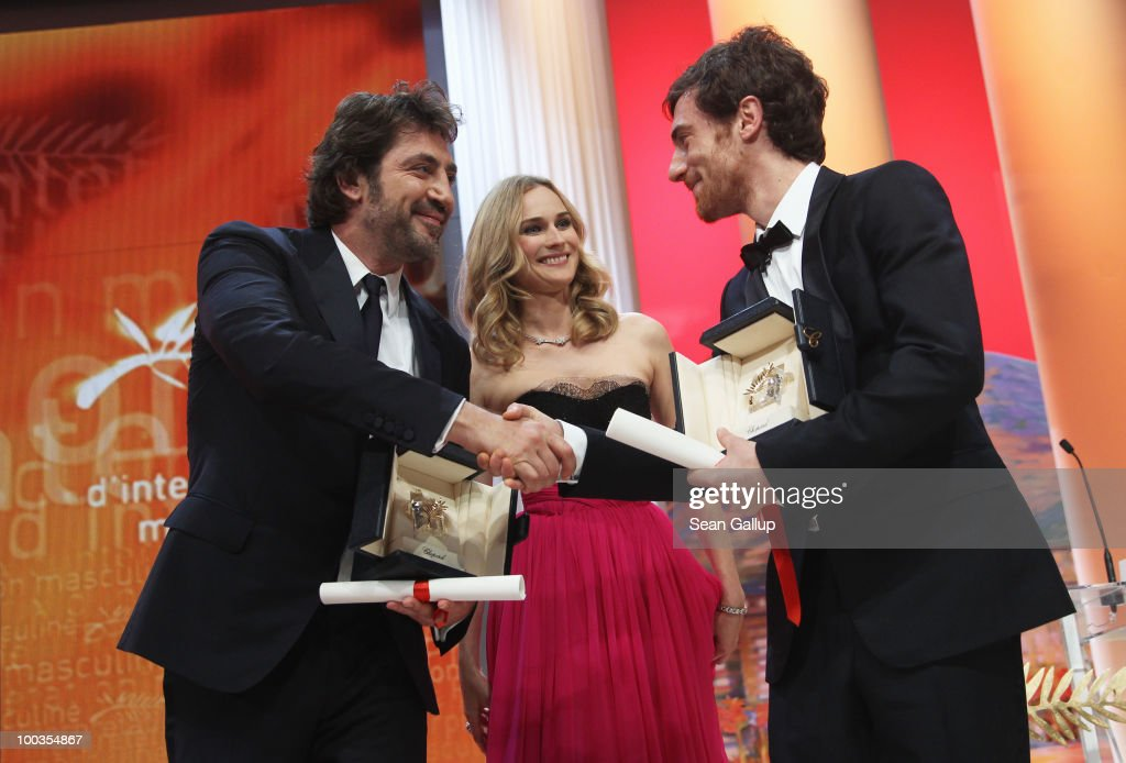 Winners of the award for Best Actor Javier Bardem (L) and Elio Germano (R) shake hands after winning as Diane Kruger looks on during the Palme d'Or Award Ceremony held at the Palais des Festivals during the 63rd Annual Cannes Film Festival on May 23, 2010 in Cannes, France.