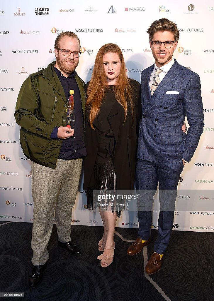 Winners of the Breakthrough Menswear Designer Award Wouter Baartmans (L) and Amber Siegel (C) with presenter Darren Kennedy at the WGSN Futures Awards 2016 on May 26, 2016 in London, England.