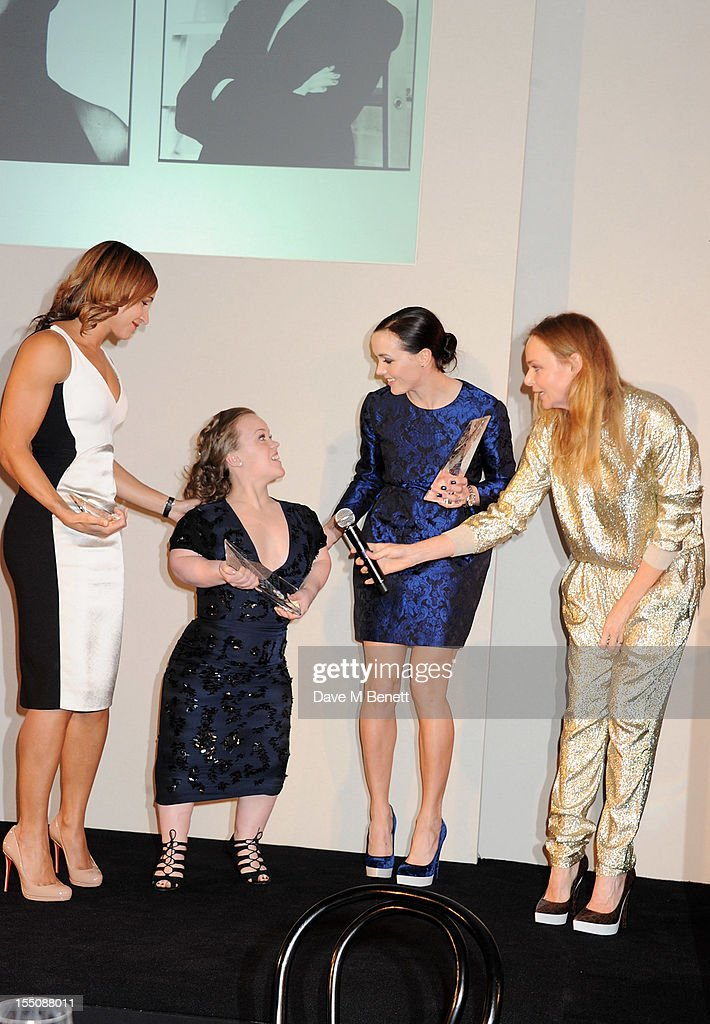 (MANDATORY CREDIT PHOTO BY DAVE M BENETT/GETTY IMAGES REQUIRED) (L to R) Winners of the British Ambassadors of the Year Jessica Ennis, Ellie Simmonds and Victoria Pendleton accept their award with British Designer of the Year winner Stella McCartney at the Harper's Bazaar Women of the Year Awards 2012, in association with Estee Lauder, Harrods and Tiffany & Co., at Claridge's Hotel on October 31, 2012 in London, England.