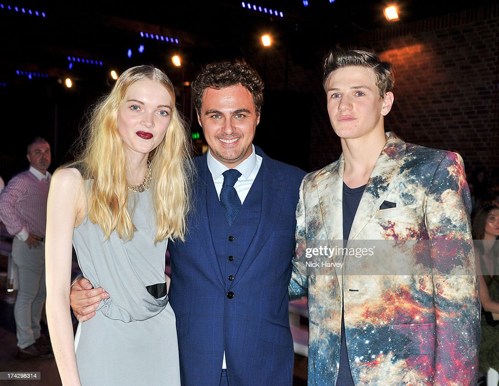 Winners of the Elite Model Management award May Bell (L) and Ross Trevillion (R) pose with the Director of Elite Model Management London Michelangelo Chiacchio at the Elite Model Look at The Brewery on July 23, 2013 in London, England.