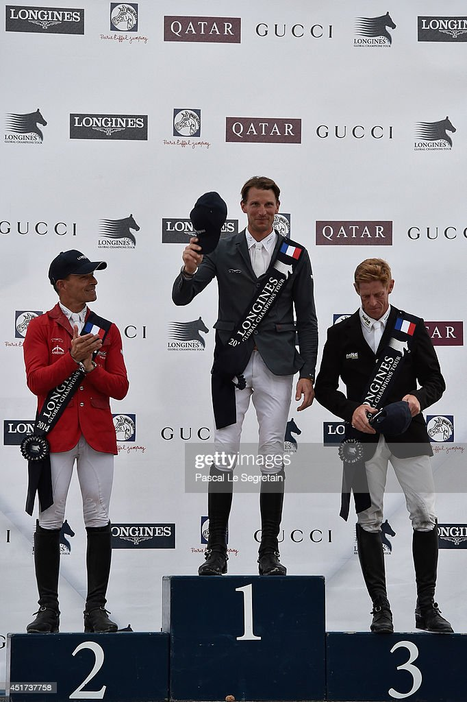Winners of the 'Longines Global Champions Tour Grand Prix of Paris Competition', (L-R) Pius Schwizer, <a gi-track='captionPersonalityLinkClicked' href=/galleries/search?phrase=Kevin+Staut&family=editorial&specificpeople=4386325 ng-click='$event.stopPropagation()'>Kevin Staut</a> and <a gi-track='captionPersonalityLinkClicked' href=/galleries/search?phrase=Marcus+Ehning&family=editorial&specificpeople=539689 ng-click='$event.stopPropagation()'>Marcus Ehning</a> pose during the Paris Eiffel Jumping presented by Gucci at Champ-de-Mars on July 5, 2014 in Paris, France.