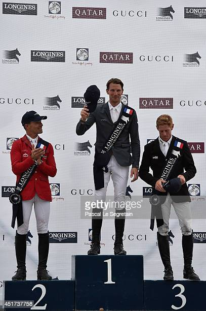 Winners of the 'Longines Global Champions Tour Grand Prix of Paris Competition' Pius Schwizer Kevin Staut and Marcus Ehning pose during the Paris...