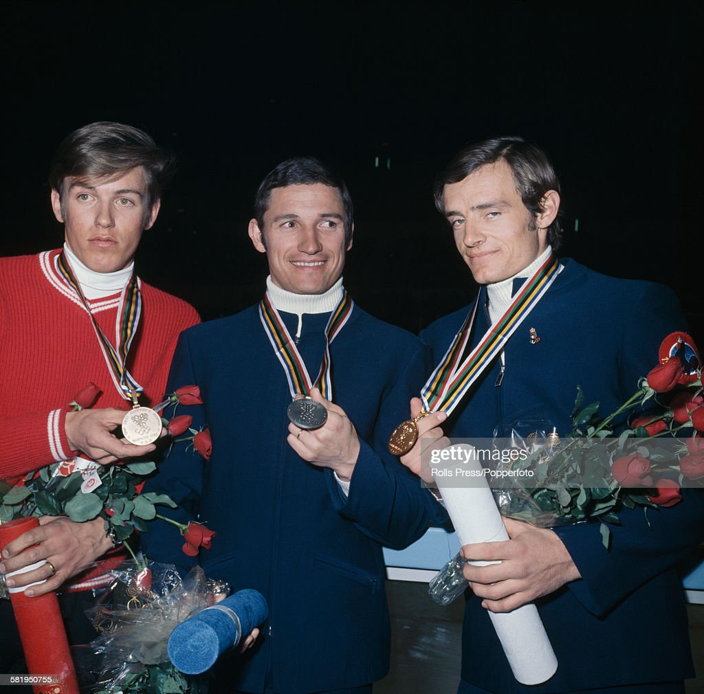 Winners of the men's downhill ski competition at the 1968 Winter Olympics pose with their respective medals at Grenoble in France in February 1968. From left to right: bronze medallist Jean-Daniel Datwyler of Switzerland, silver medallist Guy Perillat of France and gold medallist <a gi-track='captionPersonalityLinkClicked' href=/galleries/search?phrase=Jean-Claude+Killy&family=editorial&specificpeople=223880 ng-click='$event.stopPropagation()'>Jean-Claude Killy</a> of France.