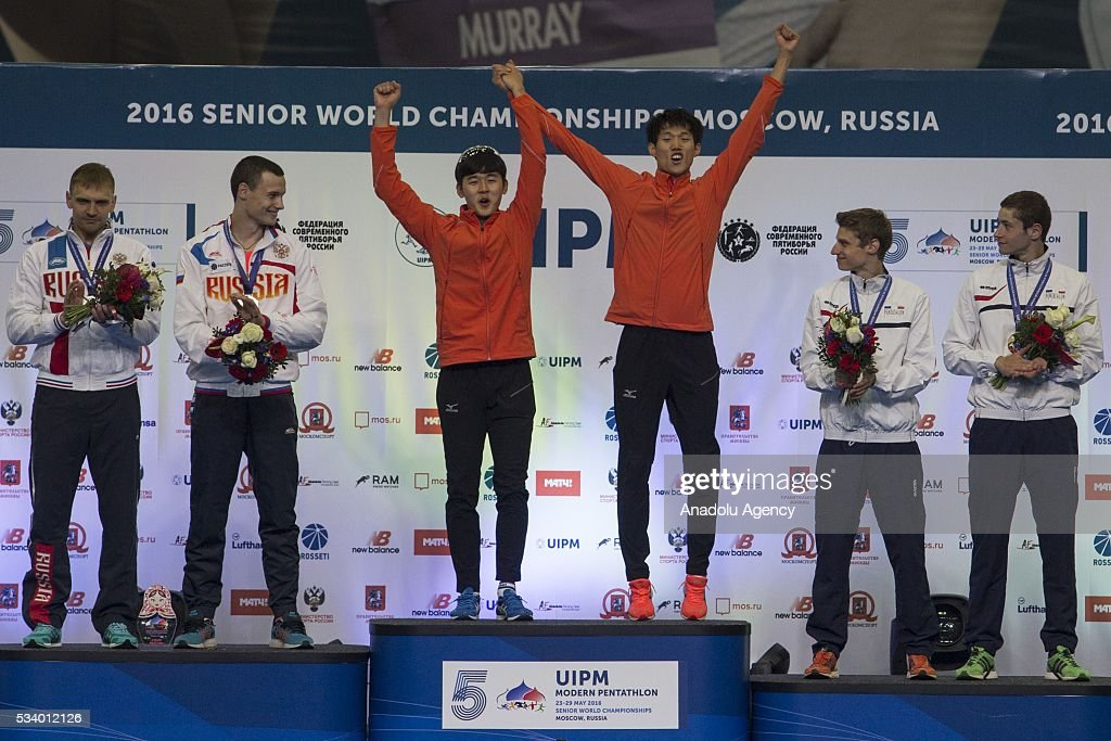 Winners of the men's relay stage the World Cup in modern pentathlon at the awards ceremony in Moscow in Olympic Sports Complex in Moscow, Russia, on May 24, 2016. From left to right: Ilya Frolov and Oleg Naumov (Russia), who won the silver medal, Vuzhin Hwang Jung Woon Dae (Korea), who won the gold medal, and Alexander Enrar and Pierre Desjardins (France), won bronze.