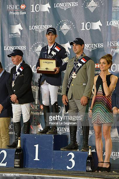 Winners of the Monaco 2015 CSI5* 160m Scott Brash John Whitaker and Emanuele Gaudiano pose on the podium as Charlotte Casiraghi stands during the...
