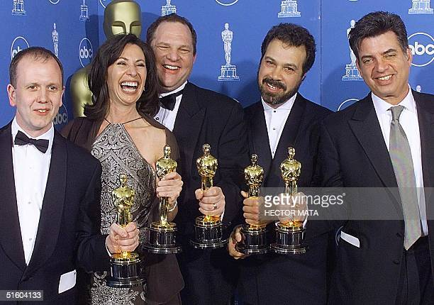 Winners of the Oscar for Best Picture 'Shakespeare in Love' pose for photographers 21 March 1999 at the Dorothy Chandler Pavilion in Los Angeles...