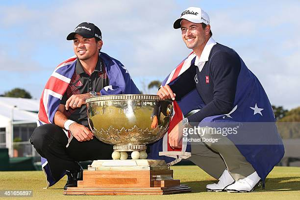Winners of the pairs Jason Day and Adam Scott of Australia pose with the trophy during day four of the World Cup of Golf at Royal Melbourne Golf...