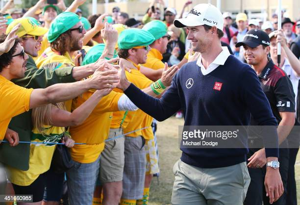 Winners of the pairsand Adam Scott and Jason Day of Australia celebrates with the fanatics during day four of the World Cup of Golf at Royal...