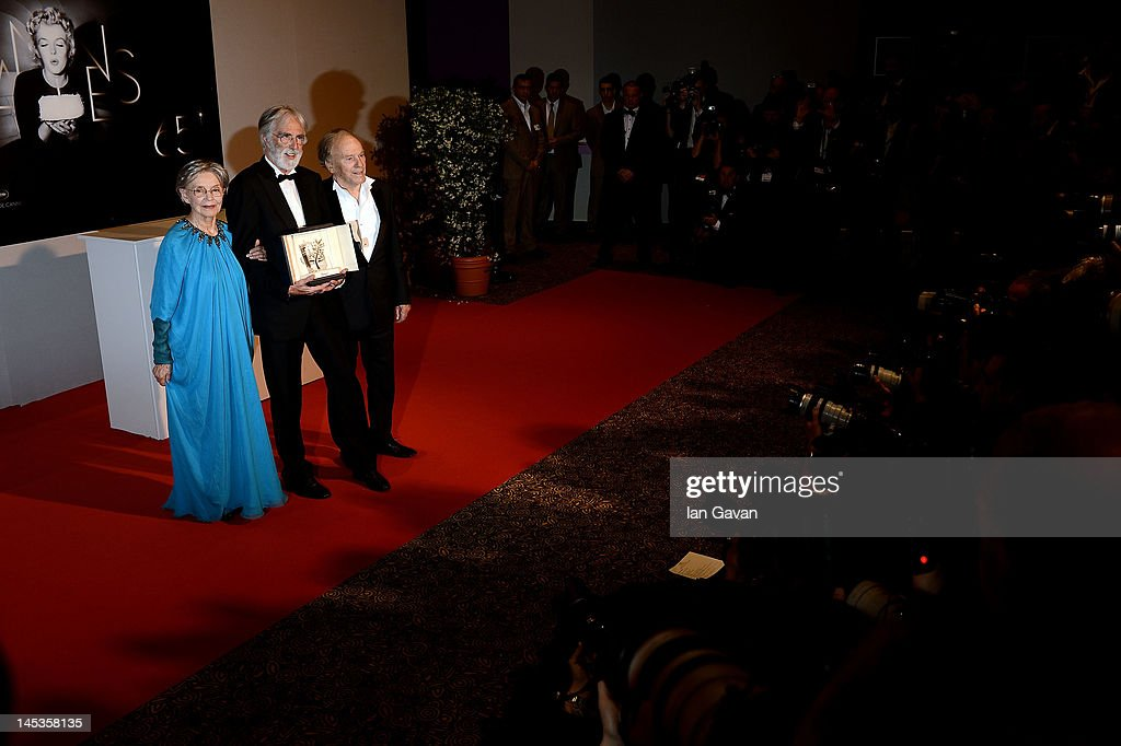 Winners of the Palme D'Or for 'Amour', actress <a gi-track='captionPersonalityLinkClicked' href=/galleries/search?phrase=Emmanuelle+Riva&family=editorial&specificpeople=2029319 ng-click='$event.stopPropagation()'>Emmanuelle Riva</a>, director <a gi-track='captionPersonalityLinkClicked' href=/galleries/search?phrase=Michael+Haneke&family=editorial&specificpeople=233739 ng-click='$event.stopPropagation()'>Michael Haneke</a> and actor <a gi-track='captionPersonalityLinkClicked' href=/galleries/search?phrase=Jean-Louis+Trintignant&family=editorial&specificpeople=1822183 ng-click='$event.stopPropagation()'>Jean-Louis Trintignant</a> pose at the Winners Photocall during the 65th Annual Cannes Film Festival on May 27, 2012 in Cannes, France.