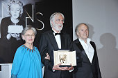 Winners of the Palme D'Or for Amour Emmanuelle Riva Michael Haneke and JeanLouis Trintignant pose at the Winners Photocall during the 65th Cannes...