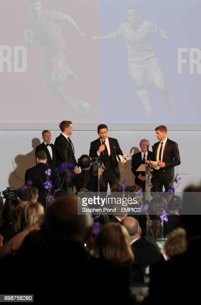 Winners of the PFA's Merit award Steven Gerrard and Frank Lampard with BT Sport presenter Jake Humphrey on stage during the PFA Awards at the...