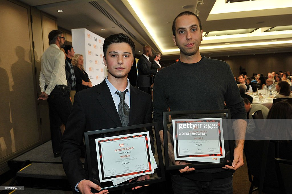 Winners of The SKYY Vodka Award for Best Canadian First Feature Film, actor Alex Ozerov (accepting on behalf of filmmaker Jason Buxton) (L) for 'Blackbird' and Brandon Cronenberg for'Antiviral' attend the 37th Toronto International Film Festival Award Winner Ceremony held at the InterContinental Toronto Center Hotel on September 16, 2012 in Toronto, Canada.