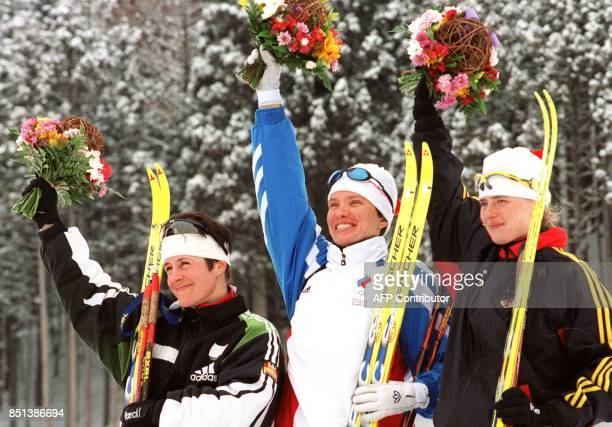 Winners of the women's 75km Olympic biathlon sprint wave from the podium in Nozawa Onsen 15 February Silver medallist Ursula Disl of Germany gold...
