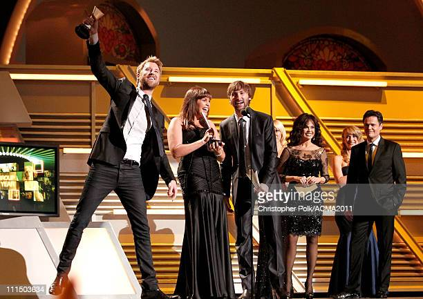 Winners of Vocal Group of the Year Lady Antebellum accept their award onstage as presenters Marie Osmond and Donny Osmand look on during the 46th...