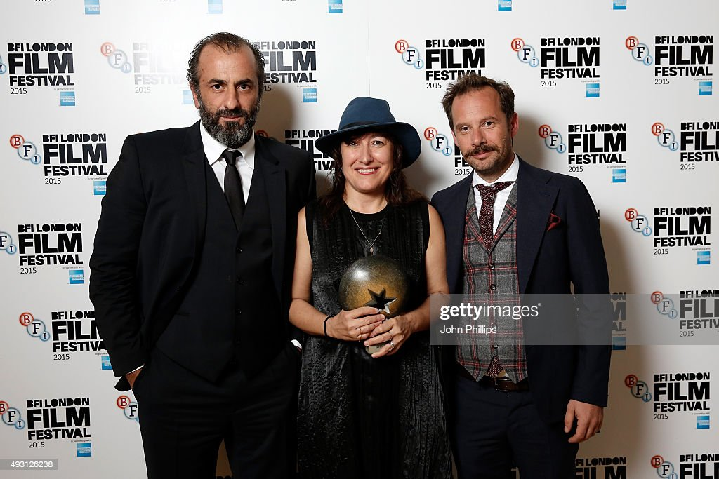 Winners Panos Koronis, Athina Rachel Tsangari and Giorgos Pyrpassopoulos pose with the Best Film Award for the film 'Chevalier' at the BFI London Film Festival Awards at Banqueting House on October 17, 2015 in London, England.