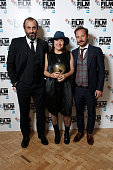 Winners Panos Koronis Athina Rachel Tsangari and Giorgos Pyrpassopoulos pose with the Best Film Award for the film 'Chevalier' at the BFI London Film...