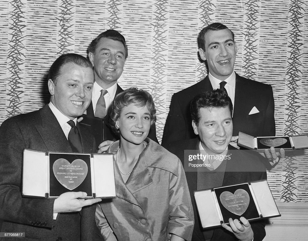 Winners posing with their awards at the Variety Club Show Business Awards; (back L-R) Michael Redgrave (best actor)and Bernard Bresslaw (promising newcomer) and (front L-R) Richard Attenborough (best film actor), Sylvia Syms (best film actress) and Max Bygraves (show business personality), at the Savoy Hotel in London, March 10th 1959.