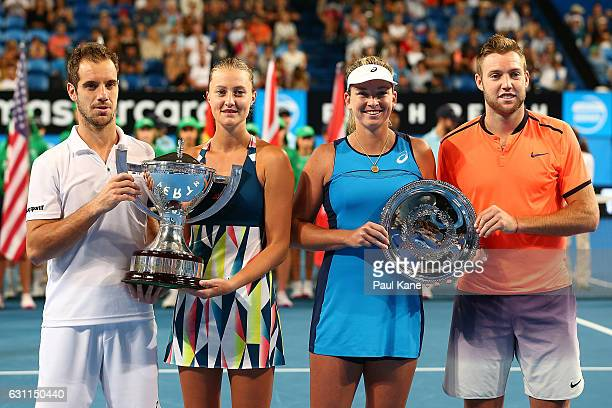 Winners Richard Gasquet and Kristina Mladenovic of France pose with runner's up Coco Vandeweghe and Jack Sock of the United States pose during the...