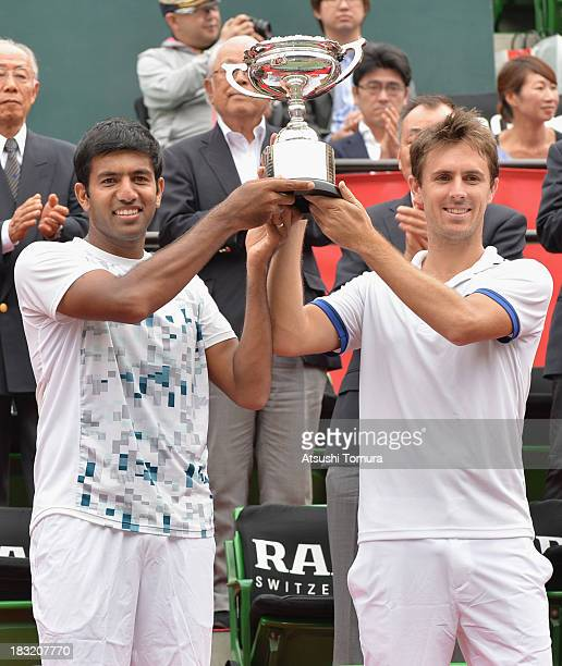 Winners Rohan Bopanna of India and Edouard RogerVasselin of France hold their plate after winning men's doubles final match against Jamie Murray of...