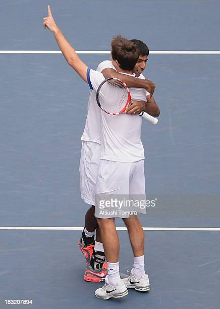 Winners Rohan Bopanna of India and Edouard RogerVasselin of France celebrate after winning men's doubles final match against Jamie Murray of Great...