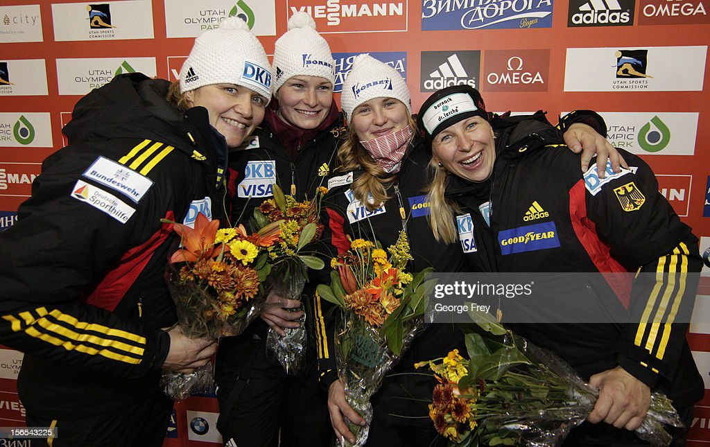Winners (L-R) Sandra Kiriasis and Franziska Bertels of Germany (2nd Place); and Stephanie Schneider and Cathleen Martini from Germany (3rd Place) celebrate their finishes in the FIBT women's bobsled world cup, on November 16, 2012 at Utah Olympic Park in Park City, Utah.