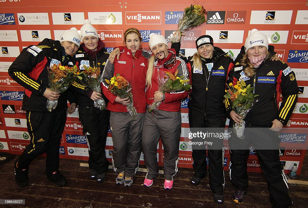 Winners (L-R) Sandra Kiriasis and Franziska Bertels of Germany (2nd Place); Chelsea Valios and Kaillie Humphries from Canada (1st Place); and Cathleen Martini and Stephanie Schneider from Germany (3rd Place) celebrate their finishes in the FIBT women's bobsled world cup, on November 16, 2012 at Utah Olympic Park in Park City, Utah.