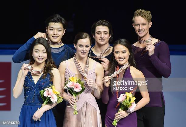 Winners Tessa Virtue and Scott Moir of Canada pose with secondplaced Maia Shibutani and Alex Shibutani of the US and thirdplaced Madison Chock and...
