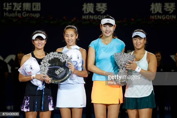Winners Yingying Duan and Xinyun Han of China with runnersup Shuai Zhang and Jingjing Lu of China pose with their trophies following the Ladies...