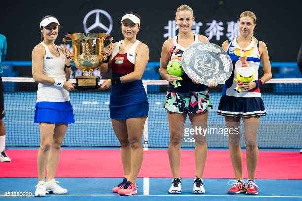 Winners YungJan Chan of Chinese Taipei and Martina Hingis of Switzerland the runnerup Timea Babos of Hungary and Andrea Hlavackova of the Czech...