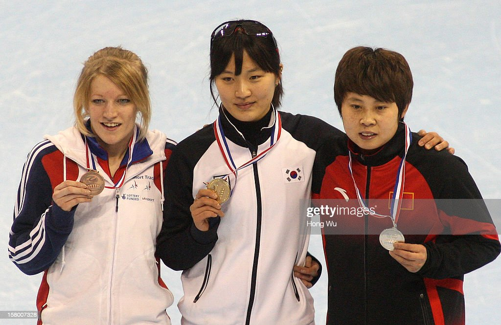 Seung-Hi Park (C) of Korea, 2nd Place:Meng Wang (R) of China, 3rd Place:<a gi-track='captionPersonalityLinkClicked' href=/galleries/search?phrase=Elise+Christie&family=editorial&specificpeople=4113885 ng-click='$event.stopPropagation()'>Elise Christie</a> (L) of Great Britain at ceremony of the Women's 1000m Final during the day one of the ISU World Cup Short Track at the Oriental Sports Center on December 8, 2012 in Shanghai, China.