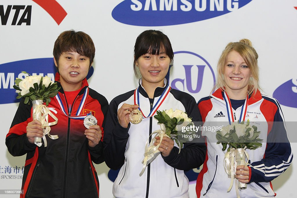 Seung-Hi Park (C) of Korea, 2nd Place:Meng Wang (L) of China, 3rd Place:<a gi-track='captionPersonalityLinkClicked' href=/galleries/search?phrase=Elise+Christie&family=editorial&specificpeople=4113885 ng-click='$event.stopPropagation()'>Elise Christie</a> (R) of Great Britain at ceremony of the Women's 1000m Final during the day one of the ISU World Cup Short Track at the Oriental Sports Center on December 8, 2012 in Shanghai, China.
