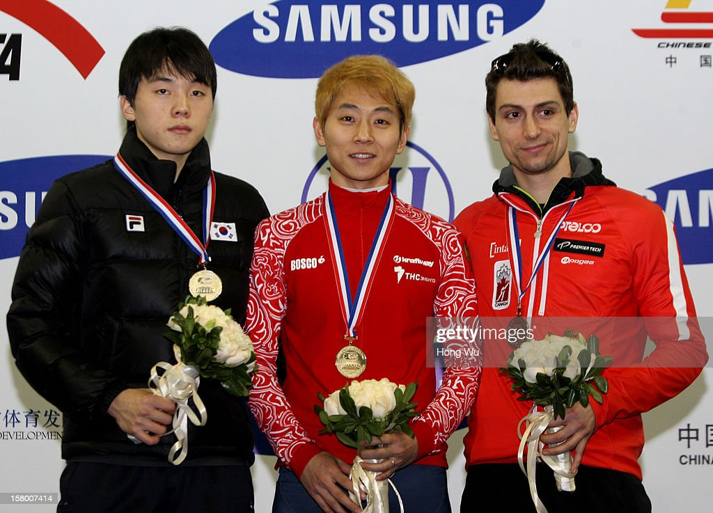 Victor An (C) of Russia, 2nd Place:Jinkyu Noh (L) of Korea, 3rd Place:Guillaume Bastille (R) of Canada at ceremony of the Men's 1500m Final during the day one of the ISU World Cup Short Track at the Oriental Sports Center on December 8, 2012 in Shanghai, China.