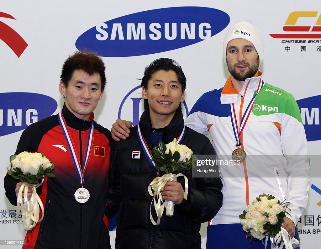 Yoon-Gy Kwak of Korea (C), 2nd Place:Wenhao Liang of China (L), 3rd Place:Niels Kerstholt of Netherlands (R) at ceremony of the Men's 1000m Final during the day one of the ISU World Cup Short Track at the Oriental Sports Center on December 8, 2012 in Shanghai, China.
