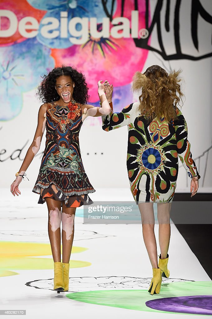 Winnie Harlow and Behati Prinsloo walk the runway at the Desigual fashion show during MercedesBenz Fashion Week Fall 2015 at The Theatre at Lincoln...