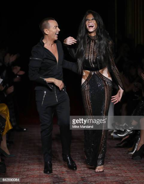 Winnie Harlow and Julien Macdonald walk at the Julien Macdonald runway during the London Fashion Week February 2017 collections on February 18 2017...