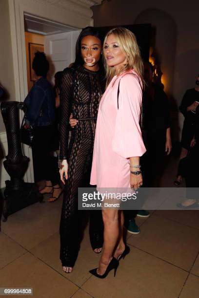 Winnie Harlow and Kate Moss attend Kate Moss Mario Sorrenti launch of the OBSESSED Calvin Klein fragrance at Spencer House on June 22 2017 in London...